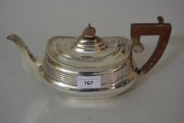 Silver teapot of oval baluster form in late Georgian style, with a gadroon rim, composite handle and
