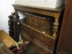 Reproduction oak court cupboard, canopy top with single panelled door, having carved decoration