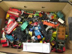 Box containing a quantity of various early playworn diecast metal vehicles including Dinky and Corgi