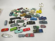 Large quantity of various playworn diecast metal model vehicles including Dinky and Corgi