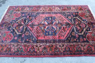 Zanjan rug with a medallion and all-over stylised design on a dark ground with borders, 2.06m x 1.4m