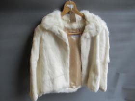 Ladies mink fur jacket, another dark fur jacket, together with a Sarah Noel white fur jacket