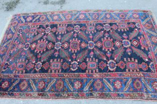 Antique Kurdish rug, having all over stylised floral design, midnight ground with multiple