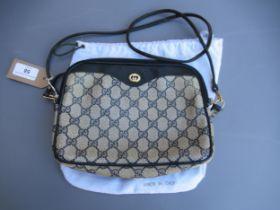 Gucci 1980's blue monogram crossbody / shoulder bag (at fault), with original dust bag Some
