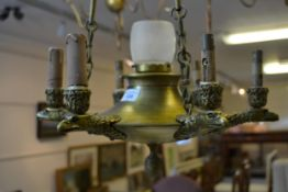 Early 20th Century Gilt bronze six branch hanging light fitting on cast chains with central glass