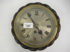Late 19th Century circular rope carved oak wall clock, the silvered dial with Roman numerals and a