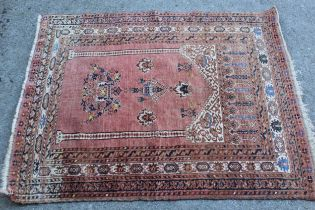 Small Afghan prayer rug with a rose ground, 48ins x 41ins approximately
