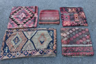 Five Kelim cushion covers and a small flat weave rug