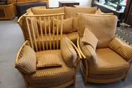Modern Ercol pale ash three piece sitting room suite comprising: a pair of armchairs and two seat