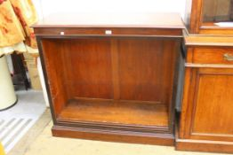 19th Century mahogany open bookcase of adjustable shelves on a plinth base, 41ins wide x 15.5ins