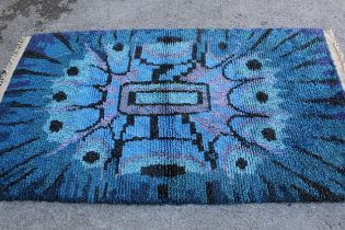 Mid 20th Century long pile rug with an abstract design in shades of blue, purple and black, possibly