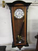 Vienna walnut and ebonised wall clock, the white enamel dial with Roman numerals and subsidiary