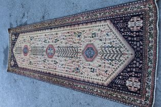 Abadeh runner with a medallion and all-over design on a blue ground with borders, 3.1m x 95cms
