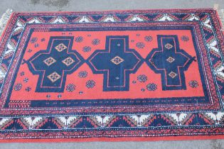 Turkish rug with triple medallion and multiple borders on a red ground, approximately 68ins x 45ins