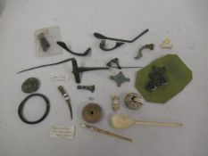 Collection of Roman and other ancient brooches, tweezers etc.