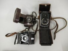 Rolleiflex, small format twin lens camera, Serial No. 523016, in original leather case together with
