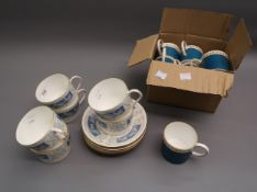 Set of six, Susie Cooper, gilt and turquoise coffee cups, with matching saucers and a set of six,