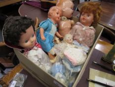 Box containing a quantity of various 20th Century plastic and composition dolls