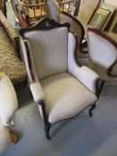 Edwardian mahogany and upholstered wing back armchair on cabriole front supports