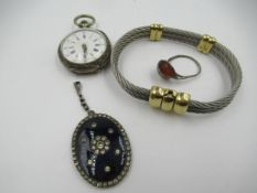 Silver cased Continental fob watch with enamel dial and Roman numerals, a silver ring mounted with