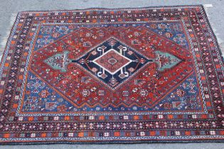 Small Qashqai rug with a lobed medallion and all-over stylised design on a red and blue ground
