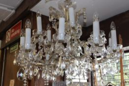 Mid 20th Century glass and gilt brass fifteen light electrolier, the shaped arms with multiple