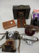 Kodak cartridge bellows camera and three other cameras and a View Master