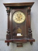 Small early 20th Century beech cased Vienna style wall clock, the painted enamel and gilded dial
