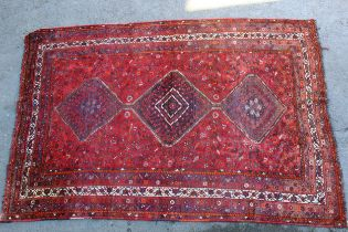 Small Shiraz carpet with a triple pole medallion and all-over stylised design on a red ground with