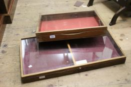 Two mahogany table top display cases with hinged glazed covers, 21ins x 16ins and 21ins x 12ins