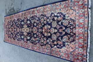 Sarouk Mahal rug with floral design on blue ground with borders, 3.6m x 1.2m