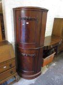 Victorian mahogany standing corner cabinet with two bow doors on a plinth base (converted from