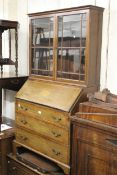 Edwardian mahogany and satinwood crossbanded bureau with an associated bookcase top, together with a