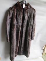 Ladies dark brown three quarter length mink fur coat together with a similar mid tan jacket