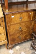 Mid 20th Century walnut chest of two short and two long drawers with brass drop handles raised on