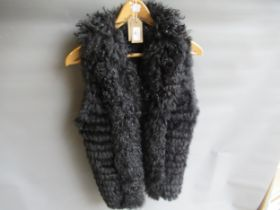 Simona Barbieri Twin-Set, ladies black fur and lace gilet and a ladies brown fur gilet by The Soho