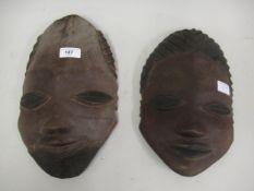 Two native carved wooden masks