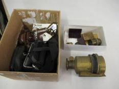 Gilt brass magic lantern lenses, together with various lens and accessories and four various cameras
