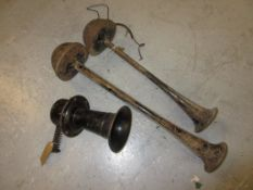 Black painted early 20th Century Klaxon horn and another early electric pair of car horns (at fault)