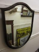 Mahogany shield shaped wall mirror, with original bevelled plate, 30ins high x 22ins wide
