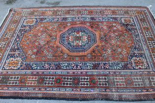 Qashqai rug of central floral medallion and all-over floral design with border, approximately