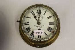Kelvin Bottomley & Baird, ships circular brass bulk head clock with enamel dial, Roman numerals
