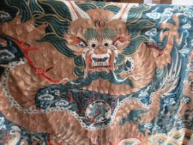 Late 19th / early 20th Century Chinese silk and gold threadwork wall hanging depicting a dragon on a