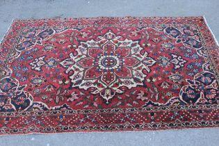 Bakhtiari rug with centre medallion and all-over floral design with border (worn), approximately