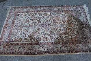 Indo Persian rug of all-over floral and bird design with multiple borders on a beige ground,