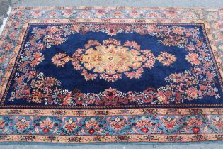 20th Century Kirman part silk rug with a lobed floral medallion and stylised floral design on a