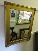 Rectangular gilt framed wall mirror, 24.5ins x 30ins,together with an Edwardian inlaid hexagonal