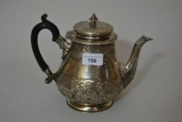 Victorian silver teapot with chased floral decoration and ebonised handle, London 1874, 24.5oz