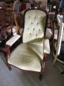 Victorian mahogany spoon back, button upholstered open armchair, raised on turned reeded supports