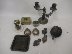 Pair of miniature metal photograph frames, onyx and gilt brass miniature chamberstick, three small